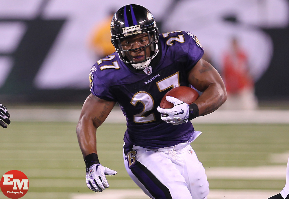 Sept 13, 2011; East Rutherford, NJ, USA; Baltimore Ravens running back Ray Rice (27) runs with the ball during the first half at the New Meadowlands Stadium.
