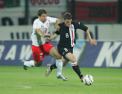 WARSAW, POLAND - WEDNESDAY, SEPTEMBER 7th, 2005: Wales' Jason Koumas and Poland's Radoslaw Sobolewski during the World Cup Group Six Qualifying match at the Legia Stadium. (Pic by David Rawcliffe/Propaganda)