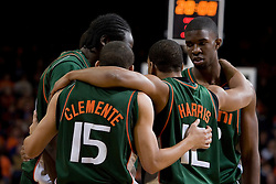 Miami Hurricanes guard Denis Clemente (15)huddles with the rest of his team before taking on Virginia.  The University of Virginia Cavaliers defeated the Miami Hurricanes Men's Basketball Team 81-70 at the John Paul Jones Arena in Charlottesville, VA on February 3, 2007.