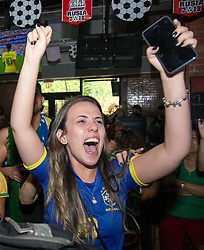 July 2, 2018 - FL, USA - Brazil supporter Carla Bastos celebrates Brazil's second goal against Mexico during a FIFA World Cup Round of 16 knockout stage watch party at Vares in Brickell on Monday, July 2, 2018. (Credit Image: © Sam Navarro/TNS via ZUMA Wire)