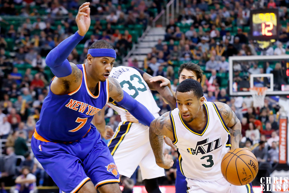 09 December 2015: Utah Jazz guard Trey Burke (3) drives past New York Knicks forward Carmelo Anthony (7) during the Utah Jazz 106-85 victory over the New York Knicks, at the Vivint Smart Home Arena, Salt Lake City, Utah, USA.