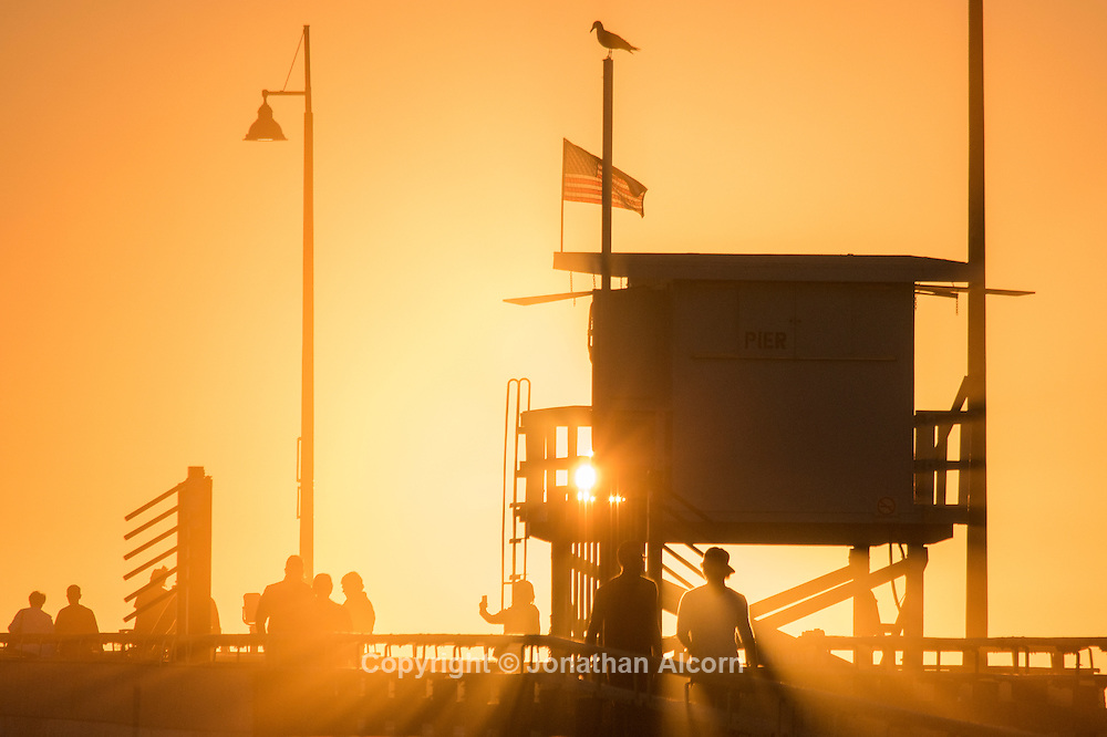 Sun rays stream through a lifeguard tower on the Venice Beach pier on a January day with a high temperature of 76 degrees on January 15, 2015 in Venice, California