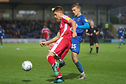 AFC Wimbledon attacker Marcus Forss (15) battles for possession during the EFL Sky Bet League 1 match between AFC Wimbledon and Gillingham at the Cherry Red Records Stadium, Kingston, England on 23 November 2019.