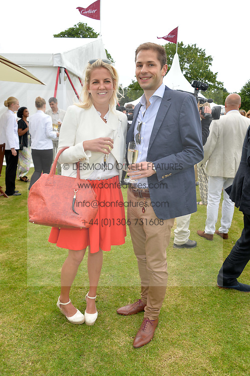 HANNELI RUPERT and SIMON PICKETT at the Cartier Queen's Cup Final polo held at Guards Polo Club, Smith's Lawn, Windsor Great Park, Egham, Surrey on 15th June 2014.