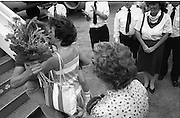 1983-15-08.15th August 1983.15-08-1983.08-15-83..Photographed at Dublin Airport..Meeting and greeting: ..Eamonn Coughlan's wife Yvonne greets the World Athletics champion with a kiss as he disembarks from his Aer Lingus flight. His mother Kathleen, back to camera, stands behind Yvonne.  .