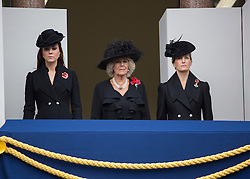 © Licensed to London News Pictures. 09/11/2014.  London.   From left to right - HRH Princess of Cambridge Kate Middleton, Camilla Duchess of Cornwall and Sophie the Countess of Wessex stand on a balcony and watch the annual Remembrance parade at the Cenotaph this morning .  This year marks the 100th anniversary of the start of World War One, 70 years since the D-Day landings and the end of Britain's conflict in Afghanistan.    Photo credit : Alison Baskerville/LNP