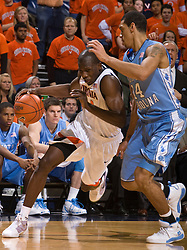 Virginia guard/forward Mamadi Diane (24) dribbles past North Carolina guard/forward Danny Green (14). The the #5 ranked North Carolina Tar Heels defeated the Virginia Cavaliers 83-61 in NCAA Basketball at the John Paul Jones Arena on the Grounds of the University of Virginia in Charlottesville, VA on January 15, 2009.