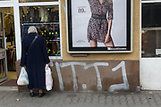 A woman window shops on the streets of Warsaw, Poland