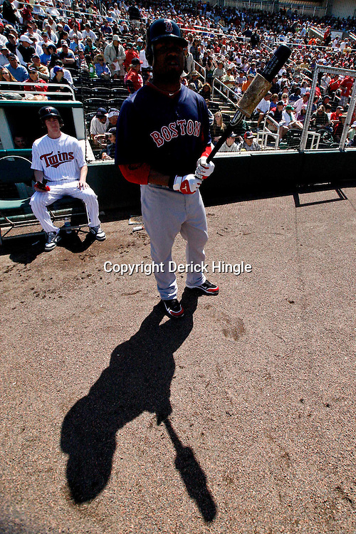 March 11, 2011; Fort Myers, FL, USA; Boston Red Sox left fielder Carl Crawford (13) waits to bat during a spring training exhibition game against the Minnesota Twins at Hammond Stadium.   Mandatory Credit: Derick E. Hingle