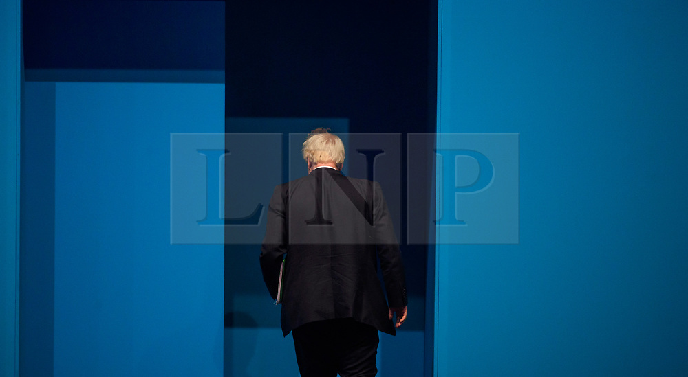 © Licensed to London News Pictures. 03/10/2017. Manchester, UK. British foreign secretary BORIS JOHNSON leaves the stage after delivering his keynote speech on day three of the Conservative Party Conference. The four day event is expected to focus heavily on Brexit, with the British prime minister hoping to dampen rumours of a leadership challenge. Photo credit: Ben Cawthra/LNP