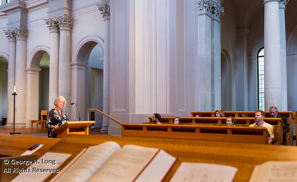 Courtney Blitch reads scriptures during a special mass for Loyola University's north shore alumni at St. Joseph Abbey in St. Benedict, Louisiana on July 30, 2017; ©2017, George H. Long