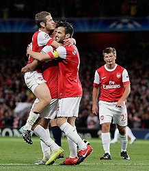 15.09.2010, Emirates Stadium, London, ENG, UEFA CL, Arsenal fc vs Sporting Braga, im Bild Arsenal's Marouane Chamakh  makes 3-0  and celebrates  expecially with Arsenal's Jack Wilshere as the provider   during Arsenal fc vs Sporting Braga for the UCL  Group  H at the Emirates Stadium in London. EXPA Pictures © 2010, PhotoCredit: EXPA/ IPS/ Marcello Pozzetti +++++ ATTENTION - OUT OF ENGLAND/UK +++++ / SPORTIDA PHOTO AGENCY