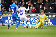 Coventry City forward Jordy Hiwula (11) is called offside before he took the ball around Peterborough Utd goalkeeper Conor O'Malley (25) during the EFL Sky Bet League 1 match between Peterborough United and Coventry City at London Road, Peterborough, England on 16 March 2019.