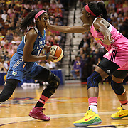 Devereaux Peters, (left), Minnesota Lynx, receives some in your face defense from Chiney Ogwumike, Connecticut Sun, during the Connecticut Sun Vs Minnesota Lynx, WNBA regular season game at Mohegan Sun Arena, Uncasville, Connecticut, USA. 27th July 2014. Photo Tim Clayton