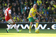 Picture by Paul Chesterton/Focus Images Ltd.  07904 640267.19/11/11.Marc Tierney of Norwich and Theo Walcott of Arsenal in action during the Barclays Premier League match at Carrow Road stadium, Norwich.