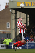 Lincoln City forward Matt Rhead (9) heads the ball  during the EFL Sky Bet League 2 match between Lincoln City and Exeter City at Sincil Bank, Lincoln, United Kingdom on 30 March 2018. Picture by Mick Atkins.