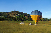Sri Lanka. .Cpt: Anil Jayasinghe gets ready for take off in front of the Kandalama hotel, Dambulla. Anil pioneered ballooning on the island.