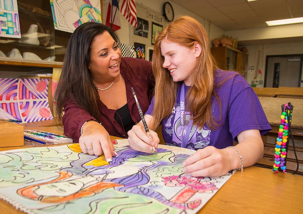Johnston Middle School art teacher Tobi Arsham works with 7th grader Makaila Maniscalco on her art work, April 22, 2015.