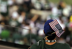 Sept 11, 2011; East Rutherford, NJ, USA;  A New York Jets fan watches the pre-game ceremonies before their game against the Dallas Cowboys at the MetLife Stadium.