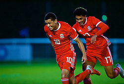 BANGOR, WALES - Monday, October 15, 2018: Wales' Brennan Johnson celebrates (L) scoring the second goal from a free kick with team-mate Christian Norton (R) during the UEFA Under-19 International Friendly match between Wales and Poland at the VSM Bangor Stadium. (Pic by Paul Greenwood/Propaganda)