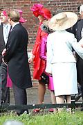 His highness prince Pieter-Christiaan of Oranje Nassau, of Vollenhoven and Ms drs. A.T. van Eijk get married  in the Great or St Jeroens Church in Noordwijk. <br /> <br /> <br /> Zijne Hoogheid Prins Pieter-Christiaan van Oranje-Nassau, van Vollenhoven en mevrouw drs. A.T. van Eijk treden in het (kerkelijk) huwelijk in de Grote St. Jeroenskerk in Noordwijk<br /> <br /> On the photo/Op de foto:<br /> <br /> <br /> <br /> De familie verlaat de Kerk ( in het rood maxima).<br /> <br /> The family leaves the church ( in red Maxima )