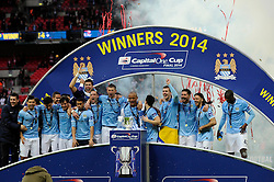 Manchester City celebrate their win in the Capital One Cup final - Photo mandatory by-line: Dougie Allward/JMP - Tel: Mobile: 07966 386802 02/03/2014 - SPORT - FOOTBALL - London - Wembley Stadium - Manchester City v Sunderland - Capital One Cup Final