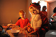 """Griffin Salerno, 7 and his sister Isabella salerno, 9 of Huntingdon Valley, Pennsylvania put together pieces of candy during the Fifth Annual """"Safe Trick or Treat"""" at General Electric Saturday October 24, 2015 in Bensalem, Pennsylvania. (Photo by William Thomas Cain)"""