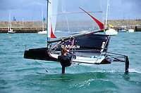 John Chambers sailing a moth dinghy