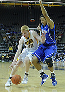 December 17, 2011: Iowa Hawkeyes forward Aaron White (30) tries to drive around Drake Bulldogs forward Jeremy Jeffers (10) during the the NCAA basketball game between the Drake Bulldogs and the Iowa Hawkeyes at Carver-Hawkeye Arena in Iowa City, Iowa on Saturday, December 17, 2011. Iowa defeated Drake 82-68.