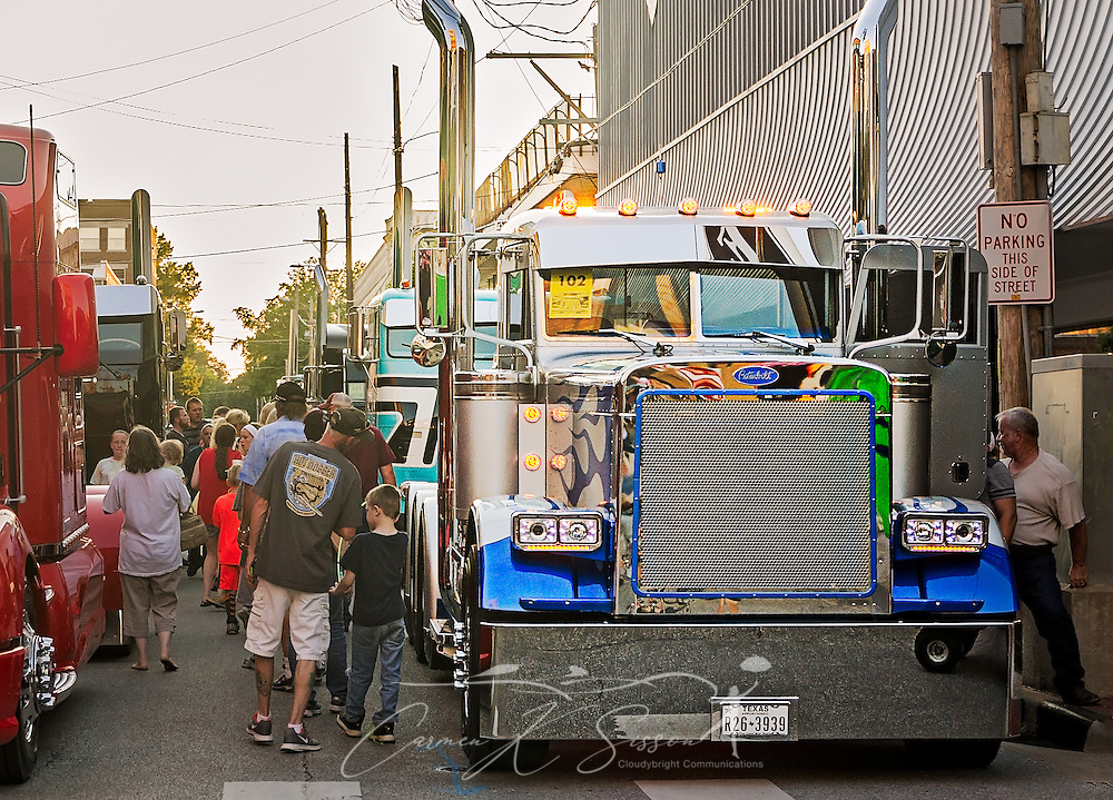 A crowd walks past Best of Show winner Jake Lindamood's truck, a 1988 Peterbilt 379, at the 34th annual Shell Rotella SuperRigs event, June 10, 2016, in Joplin, Missouri. SuperRigs, organized by Shell Oil Company, is an annual beauty contest for working trucks. Approximately 89 trucks entered this year's competition. (Photo by Carmen K. Sisson/Cloudybright)