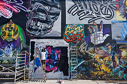 "© Licensed to London News Pictures. 28/05/2018. LONDON, UK. Core246, a street artist, at work at ""Meeting of Styles"" near Brick Lane in East London.  The three day festival celebrates street art, with artists from around the world demonstrating their skills.  Photo credit: Stephen Chung/LNP"