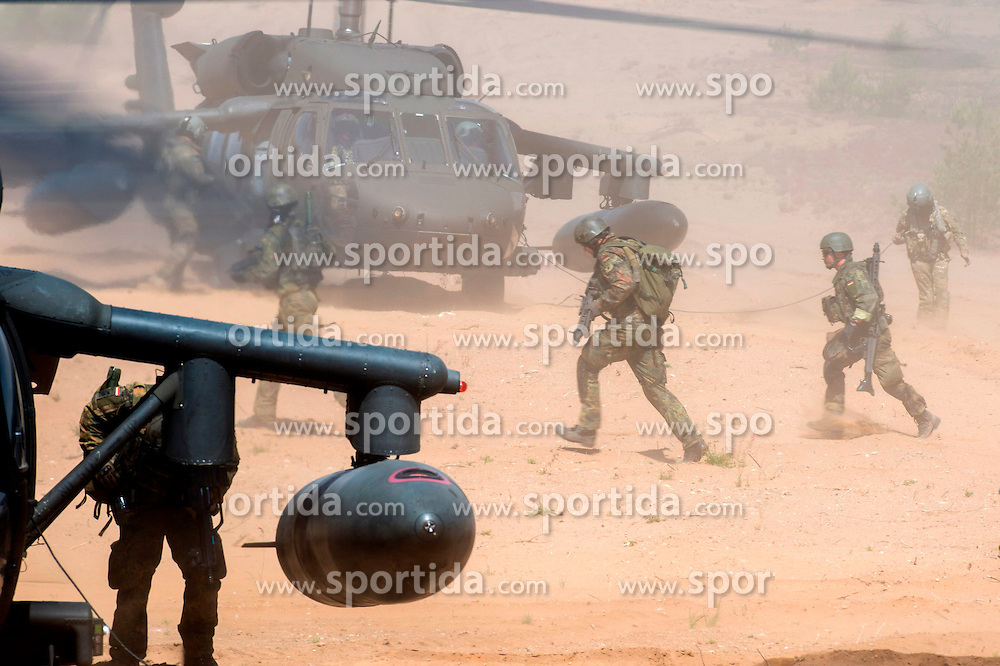 Soldiers act in the second phase of Saber Strike 2015 multi-nation military exercises in Pabrade, Lithuania, June 12, 2015. The second phase of Saber Strike 2015 is held in Lithuania from June 8 till 19. EXPA Pictures &copy; 2015, PhotoCredit: EXPA/ Photoshot/ Alfredas Pliadis<br /> <br /> *****ATTENTION - for AUT, SLO, CRO, SRB, BIH, MAZ only*****