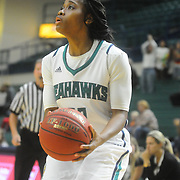 UNCW's Amber Reeves pulls up to shoot against William and Mary Sunday January 4, 2015 at Trask Coliseum on the campus of UNCW. (Jason A. Frizzelle)
