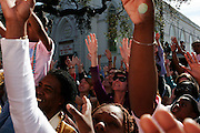New Orleans, Louisiana. United States. February 28th 2006..People ask for beads at the Zulu Parade on Saint Charles Avenue.