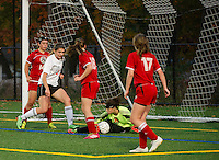 Berlin's goalie Rylie Binette makes the save against Laconia's Morgan Gamans during NHIAA Division III Soccer on Tuesday evening.  (Karen Bobotas/for the Laconia Daily Sun)