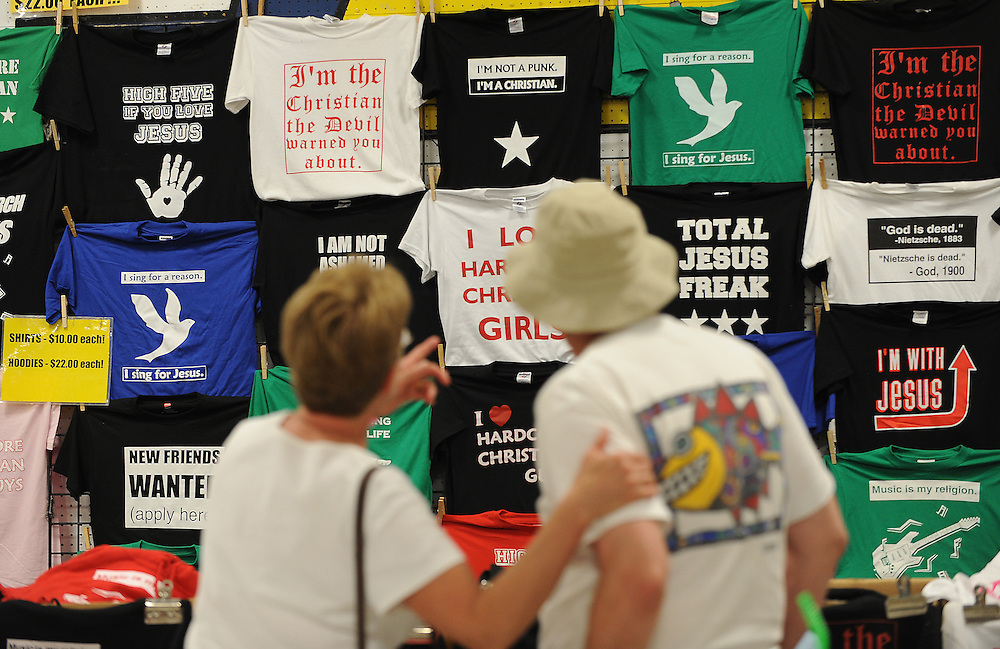 T-shirts with religious messages hang from a wall at Lifest, a Christian music festival in Oshkosh, Wis. (Sam Lucero photo)