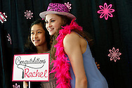 Elite gymnasts Victoria Nguyen, 15 (left), and Rachel Gowey, 18, take a picture together in a photo booth area Sunday, May 22, 2016, during Gowey's graduation party at Palmer's Deli in Urbandale.