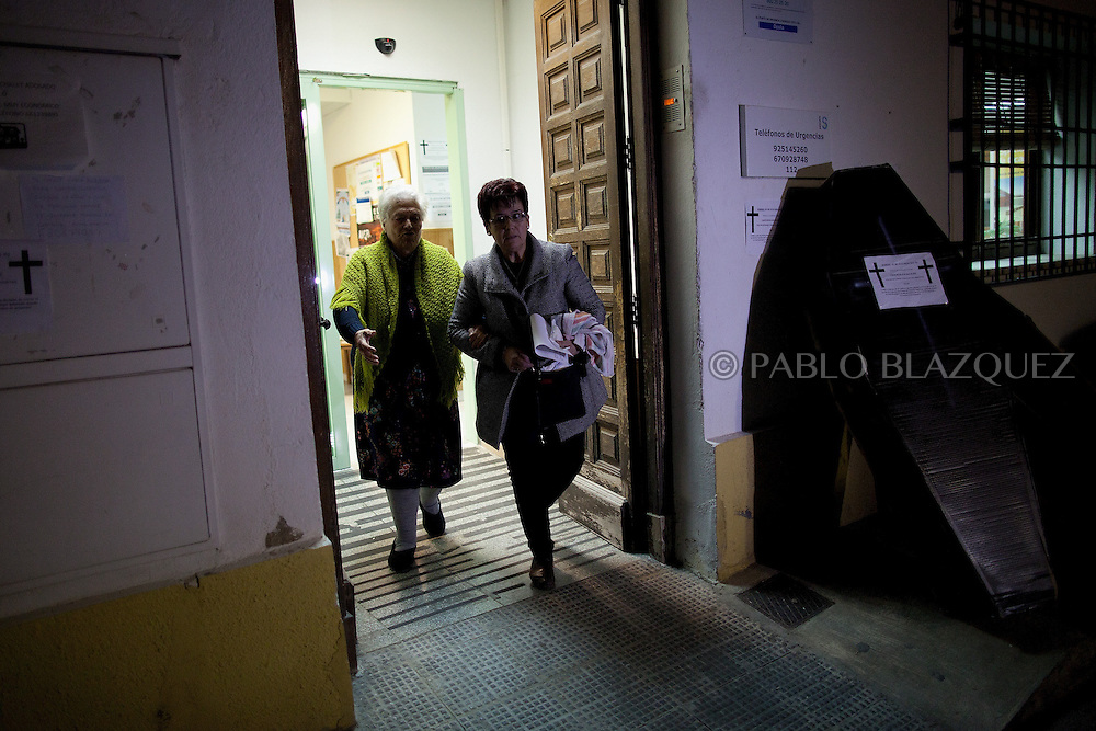 An elderly woman that has been treated from a head injury leaves the local healthcare centre which closes at 8pm tonight its emergency hours on January 14, 2013 in Tembleque, near Toledo, Spain. A total of 21 centres, specially in rural areas, in the region of Castilla-La Mancha, are eliminating emergency hours services following budget cuts and privatisations in Spanish health services.