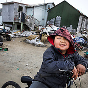 Wendell Kuzuguk, 10, rides his bicycle in Shishmaref, Alaska, an Inupiat community of about 600 people near the Bering Strait. The residents of Shishmaref voted to relocate because their island is steadily disappearing because of erosion and flooding due to climate change. Only one quarter mile wide and two and half miles long, Shishmaref has been  grappling with rising sea levels that have eroded more than 200 feet of the village, since 1969, according to a relocation study published in February. Climate change has resulted in a reduction in the sea ice which buffers Shishmaref from storm surges. At the same time, the permafrost that the village is built on has also begun to melt, making the shore even more vulnerable to erosion. The Inupiat rely heavily on a subsistence lifestyle, hunting and gathering much of their food. Shishmaref is one of at least 31 Alaska Native villages under imminent threat due to climate change, according to a 2009 report from the Government Accountability Office.