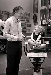 14 July 13. New Orleans, Louisiana.<br /> Henry Harris gets his first hair cut with Aidan Gill in New Orleans.. <br /> Photo; Charlie Varley