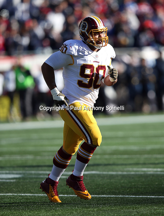 Washington Redskins defensive end Stephen Paea (90) jogs cross field during the 2015 week 9 regular season NFL football game against the New England Patriots on Sunday, Nov. 8, 2015 in Foxborough, Mass. The Patriots won the game 27-10. (©Paul Anthony Spinelli)