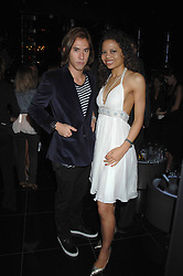 EDWARD TANG and EMMA McQUISTON at the grand opening of the Amika nightclub, 65 High Street Kensington, London on 28th February 2007.<br />