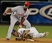 New York Mets' Jose Reyes collides with Cincinnati Reds second baseman Brandon Phillips to stretch a single to a double in a baseball game on JUlY 12, 2007 in New York.