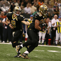 13 January 2007: New Orleans Saints quarterback Drew Brees (9) hands off to running back Deuce McAllister (26) during a 27-24 win by the New Orleans Saints over the Philadelphia Eagles in the NFC Divisional round playoff game at the Louisiana Superdome in New Orleans, LA. The win advanced the New Orleans Saints to the NFC Championship game for the first time in the franchise's history.