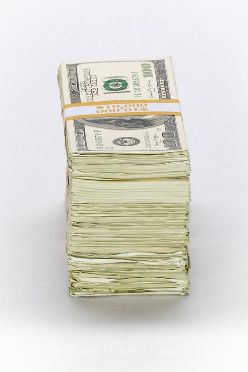 Stack of American $100 bills paper money short side