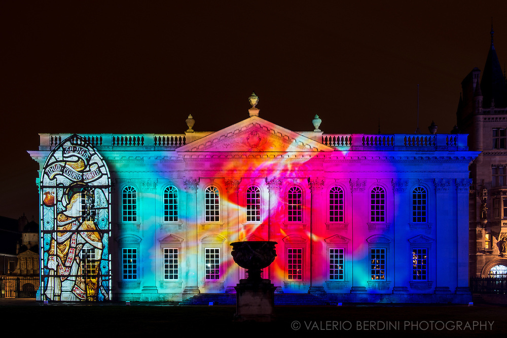 Light projection over Senate House, University of Cambridge. e-Luminate Cambridge is a contemporary arts festival at the forefront of scientific and technological research. A unique opportunity to discover the richness and diversity of Cambridge's iconic buildings and public spaces in a new light. e-Luminate Cambridge has been at the forefront of this vibrant and expanding area of artistic practice, called Light Art, promoting innovation through its support of some of the most exciting figures on the contemporary scene.