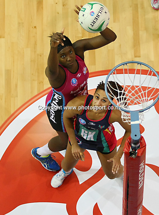 Steels Jhaniele Fowler-Reid, left, takes a shot at goal while defended by Vixens Geva Mentor in the ANZ championship netball match, Steel v Vixens, ILT Stadium Southland, Invercargill, New Zealand, Saturday, May 31, 2014. Photo: Dianne Manson / www.photosport.co.nz