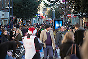 © Licensed to London News Pictures. 19/12/2014. Kingston Upon Thames, UK Shoppers in Kingston Upon Thames today 19th December 2014. Today is the last Friday before Christmas. Photo credit : Stephen Simpson/LNP
