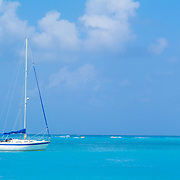 Sailboat in turquoise waters. Cancun, Quintana Roo. Mexico.