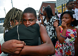 14 September 2013. Prayer Tower Church of God in Christ. New Orleans, Louisiana. <br /> Family and friends weep at the funeral for 11 yr old Arabian 'Ray Ray' Gayles, fatally shot September 2nd. Arabian was cradling a 1 yr old cousin whilst sat on the couch at home when gunmen pulled up outside and sprayed the house with bullets. Arabian was hit in the head and died shortly afterwards. NOPD is questioning 2 men in connection with the murder.<br /> Photo; Charlie Varley